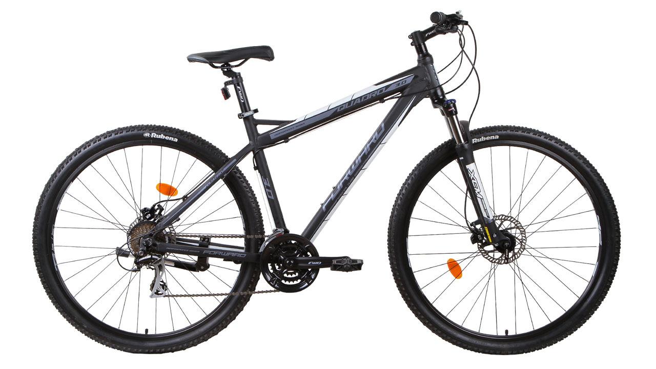 """Forward Quadro 3.0 29 Disc (2015)Горные<br>Самую высокую проходимость и при этом высокую скорость движения вам обеспечит велосипед FORWARD QUADRO 3.0 29 DISC (2015) за счёт установленных на него колёс диаметром в 29"""". Такие велосипеды называют «найнеры» (с англ. Nine – это девять). Колёса собраны на базе прочных и лёгких алюминиевых двойных ободов. Передний и задний переключатели с 21 скоростным режимом позволяют лучше разгоняться на прямых участках дороги и не уставать при подъёме в горку.<br>Велосипед оборудован дисковыми гидравлическими тормозами. Такой вид тормозов является наиболее популярным и эффективным при использовании во время экстремального катания: он обладает высокой мощностью и не требует постоянной подстройки.<br>"""