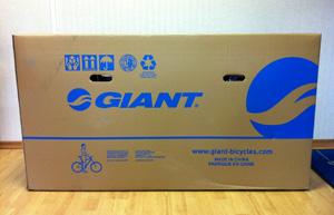 Велосипед в коробке - вид спереди
