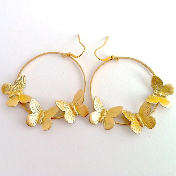 Купите круглые серьги-бабочки от Susana Espiauba