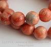 Бусина Говлит (тониров), шарик, цвет - персиково-коралловый, 10 мм, нить