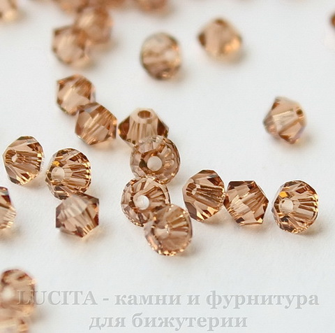 5328 Бусина - биконус Сваровски Light Smoked Topaz 3 мм, 10 штук
