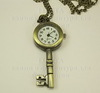 """Часы на цепочке """"Ключик"""" (цвет - античная бронза) 55х26х7 мм(лев) ()"""