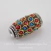 """Бусина """"Индонезийская"""" ручной работы коричневая с красным и голубым, 32х18 мм"""