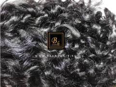 Кучерявый шиньон из натуральных волос