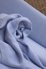 100% лён смягченный, цвет  насыщено голубой.