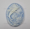 """Камея """"Рыба-меч """" белого цвета  на голубом фоне 40х30 мм"""